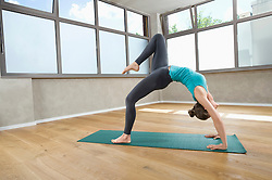 Woman alone fit fitness studio Yoga exercise