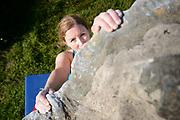 Tiffani Canevari climbing a the Sunset Bouders in Sonoma Coast State Park, Sonoma County, California