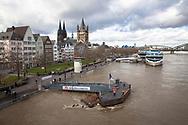 Cologne, Germany, February 4th. 2021,, flood of the river Rhine, the old part of town with the cathedral and the church Gross St. Martin.<br /> <br /> Koeln, Deutschland, 4. Februar 2021, Hochwasser des Rheins, die Altstadt mit dem Dom und der Kirche Groß St. Martin.