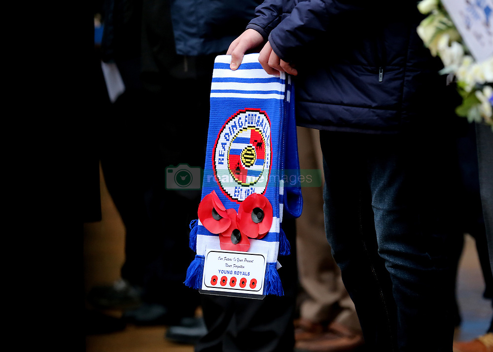 A Reading scarf is decorated with Poppies as Reading FC hold an act of Remembrance outside the stadium before the match during the Sky Bet Championship match at the Madejski Stadium, Reading.