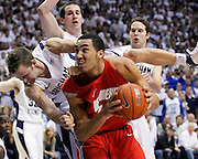 BYU guard Jackson Emery, top, falls on top of New Mexico forward Drew Gordon, bottom, during the second half of an NCAA college basketball game in Provo, Utah, Wednesday, March. 2, 2011. New Mexico defeated 3rd ranked BYU 82-64. (AP Photo/Colin E Braley)