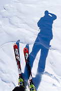 Backcountry skis and skier's silhouette, Inyo National Forest, Sierra Nevada Mountains, California