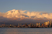 The autumn sun illuminates the Seattle skyline and dramatic clouds above the city. (Erika Schultz / The Seattle Times)