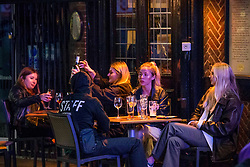 Licensed to London News Pictures. 23/09/2020. London, UK. Members of the public making the most of Wednesday evening in Soho, central London. It could be the last big night out of 2020 before pubs and bars are forced to comply with a new 10pm curfew. Photo credit: Marcin Nowak/LNP