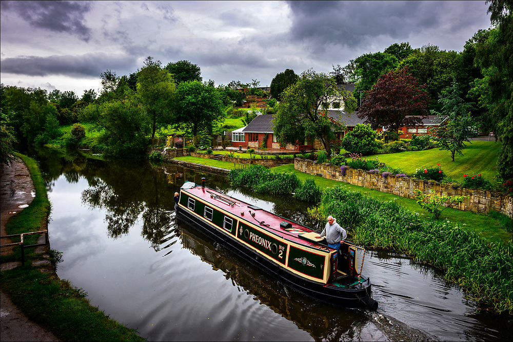 Near Wigan, where George Orwell wrote about the plight of the working class some 75 years ago, a pleasure boat cruises the 127-mile long Leeds-Liverpool Canal, the longest in Northern England.  © Steve Raymer / National Geographic Creative
