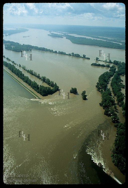 Floodwaters pour back into Mississippi thru manmade cut in levee on 8/4/93 near Prairie du Rocher Illinois