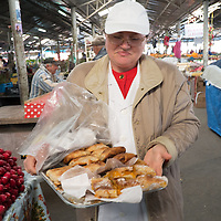 TIMISOARA, ROMANIA - APRIL 21:  A stall owner sells swetts at the daily market on April 21, 2013 in Timisoara, Romania.  Romania has abandoned a target deadline of 2015 to switch to the single European currency and will now submit to the European Commission a programme on progress towards the adoption of the Euro, which for the first time will not have a target date. (Photo by Marco Secchi/Getty Images)