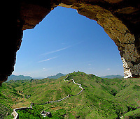 The great wall snakes its way across the mountains from Simatai to Jinshanling.