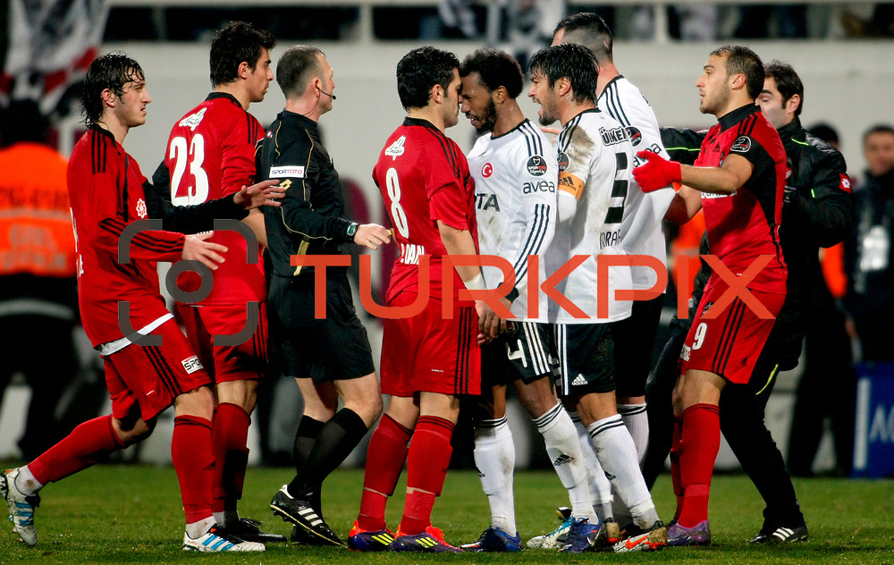 Besiktas's Manuel Fernandes ((3ndR)) and Gaziantepspor's Bekir Ozan Has (C) during their Turkish superleague soccer match Besiktas between Gaziantepspor at BJK Inonu Stadium in Istanbul Turkey on Tuesday, 05 January 2012. Photo by TURKPIX