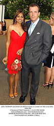 JOEL CADBURY and DIVIA LALVANI at a party in London on 16th June 2004.<br /> PWG 484