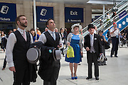 Waiting for the train, Royal Ascot racegoers From Japan,  at Waterloo station. London. 19 June 2013.