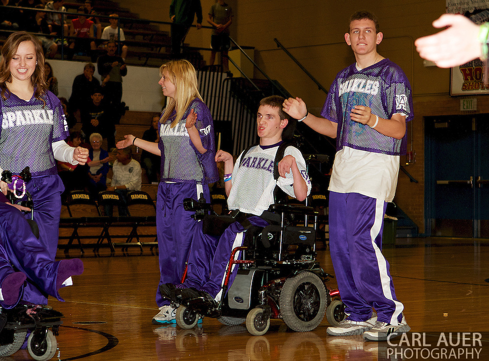 Arvada West junior, AJ Novotny (in white jersey) performs at Wheat Ridge High School for the Sparkles final performance of the season.