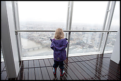 A little girl looks at the view from the Shard as the London Mayor Boris Johnson officially opens the Shard building to the General public, central London, Friday February 1, 2013. Photo By Andrew Parsons / i-Images
