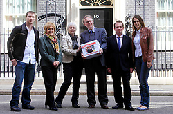 © Licensed to London News Pictures 24/04/2013.Bookshop owners Keith and Frances Smith hand in a petition of over 157,000 signatures to Downing Street, challenging Amazon over its reduced payment of UK corporate tax. From left, David Smith (son), Margaret Hodges MP, Frances and Keith Smith, Chris White MP for Warwickshire, and Jennifer Strejevitch (daughter-in-law)..London, UK.Photo credit: Anna Branthwaite/LNP