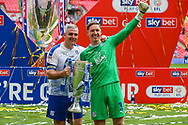 Tranmere Rovers defender Steve McNulty (5) and Tranmere Rovers goalkeeper Scott Davies (1) pose for photos after winning the final during the EFL Sky Bet League 2 Play Off Final match between Newport County and Tranmere Rovers at Wembley Stadium, London, England on 25 May 2019.