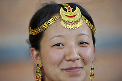 August 9, 2016 - Kathmandu, NP, Nepal - A Portrait of Yatri Yakkha, 23 yrs old, Nepalese Kirati girl in a traditional attire smiles as participate in the International Day of the 22nd World Indigenous Day celebrated in Kathmandu, Nepal, 09 August 2016. At the call of the United Nations, on August 9 every year the International Day of the World's Indigenous People observed by organizing different programs. (Credit Image: © Narayan Maharjan/Pacific Press via ZUMA Wire)