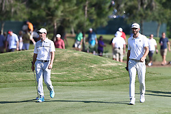 May 11, 2017 - Ponte Vedra Beach, Florida, United States - Rory McIlroy (L) and Dustin Johnson approach the 12th green during the first round of The PLAYERS Championship at TPC Sawgrass. (Credit Image: © Debby Wong via ZUMA Wire)