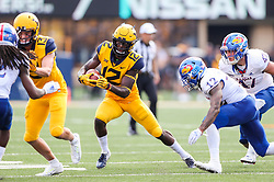 Oct 6, 2018; Morgantown, WV, USA; West Virginia Mountaineers wide receiver Gary Jennings Jr. (12) catches a pass and runs for extra yards during the third quarter against the Kansas Jayhawks at Mountaineer Field at Milan Puskar Stadium. Mandatory Credit: Ben Queen-USA TODAY Sports