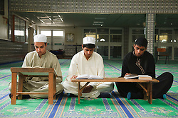 Muslim boys reading the Koran in a Mosque.