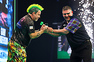 Peter Wright and Gary Anderson at the end of their match during the Unibet PDC Premier League of darts at Marshalls Arena, Stadium MK, Milton Keynes, England. UK on 7 April 2021.