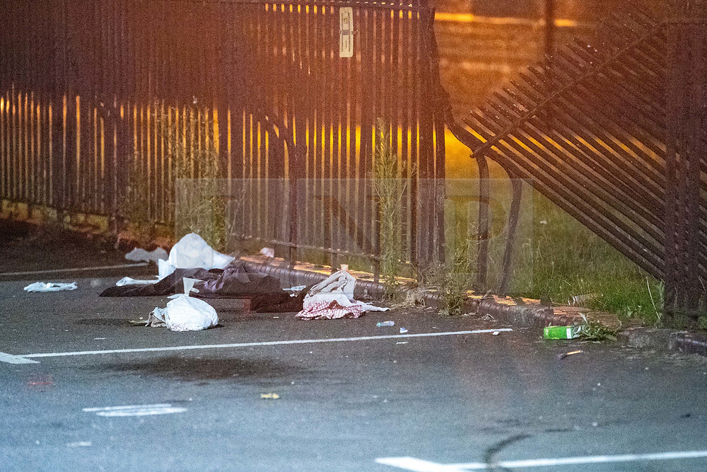 © Licensed to London News Pictures. 20/07/2020. London, UK. Clothes sit next to a damaged fence after a person was rammed by a vehicle on Scott Street in Bethnal Green. An investigation has been launched after a person was rammed by a car in Bethnal Green, the person was rammed by the vehicle into a fence. Photo credit: Peter Manning/LNP
