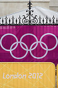 The IOC's Olympic logo brand of rings on a banner at Horse Guards in Whitehall during the London 2012 Olympics. Wrought iron railings are seen behind the banner at the sports venue hosting the volleyball in the centre of Westminster where governmental offices are located.