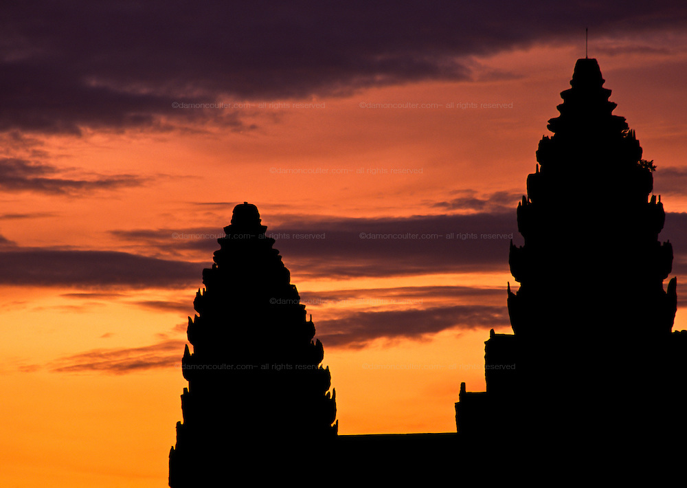 Sunrise over the towers of Angkor Wat temple in the Angkor Archeological Park in Siem Riep. Cambodia. August 2002