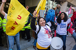 London, UK. 26th February, 2019. Susana Benavides (c), who was last week awarded £75,000 in compensation by an employment tribunal after being dismissed unfairly from her subcontracted cleaning job at Topshop, joins mainly migrant striking outsourced workers belonging to the Independent Workers of Great Britain (IWGB), United Voices of the World (UVW) and Public and Commercial Services Union (PCS) trade unions working at the University of London (IWGB), Ministry of Justice (UVW) and Department for Business Energy and Industrial Strategy (PCS), together with representatives of the National Union of Rail, Maritime and Transport Workers (RMT) Regional Council, taking part in a 'Clean Up Outsourcing' demonstration to call for an end to the practice of outsourcing. The demonstration was organised to coincide with a significant High Court hearing of an application by the IWGB for judicial review of a decision by the Central Arbitration Committee (CAC) not to hear their application for trade union recognition for the purposes of collective bargaining with the University of London.