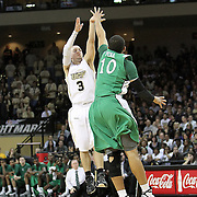 Central Florida guard A.J. Rompza (3) shoots over Marshall guard/forward Dago Pena (10) during a Conference USA NCAA basketball game between the Marshall Thundering Herd and the Central Florida Knights at the UCF Arena on January 5, 2011 in Orlando, Florida. Central Florida won the game 65-58 and extended their record to 14-0.  (AP Photo/Alex Menendez)