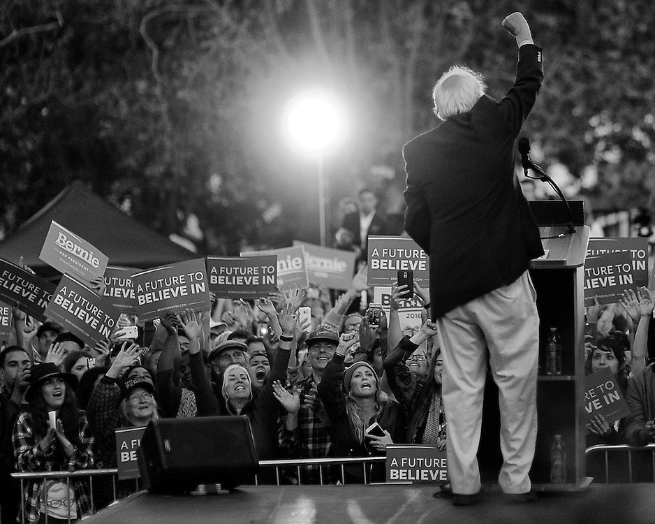 Sen. Bernie Sanders (Ind-Vermont) pumps his fist in front of thousands of supporters after delivering his stump speech outside of Colton Hall in Monterey, California on May 31, 2016.