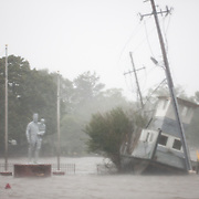 NEW BERN, NC - SEPTEMBER 14,  2018:  Flood waters rise up by a Statue by what was once the water front near Front Street on Neuse River in New Bern, NC on September 14, 2018 during Hurricane Florence.  Logan Cyrus for AFP