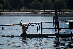 © Licensed to London News Pictures. 13/06/2021. London, UK. Member son the public prepare to take a dip in the early morning sunshine in Hyde Park central London on a hot summer's day. Temperatures in the capital are expected to reach a high for the year. Photo credit: Ben Cawthra/LNP