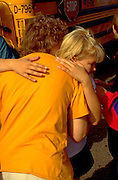 Mother age 32 saying good bye to daughter age 9 for summer camp.  St Paul  Minnesota USA