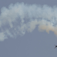 Aerobatic european champion Zoltan Veres of Hungary flies with his airplane during an air show above river Danube crossing central Budapest, Hungary on May 01, 2013. ATTILA VOLGYI