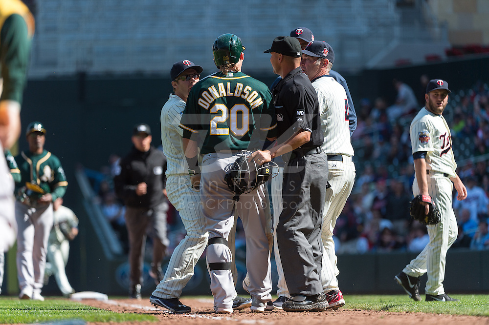 Josh Donaldson #20 of the Oakland Athletics and Glen Perkins #15 of the Minnesota Twins argued on the field leading to the benches clearing on April 9, 2014 at Target Field in Minneapolis, Minnesota.  The Athletics defeated the Twins 7 to 4.  Photo by Ben Krause