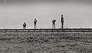 Boys fishing by Railway line