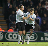 Photo: Lee Earle.<br /> Portsmouth v Chelsea. The Barclays Premiership.<br /> 26/11/2005. Chelsea's Joe Cole (R) congratulates Frank Lampard after he scored their second.