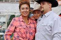 Lisette Flores, Ricardo Flores, and their son Ricardo Jr. pose for pictures at the Kid's Corral on Friday night at the 2013 California Rodeo Salinas.
