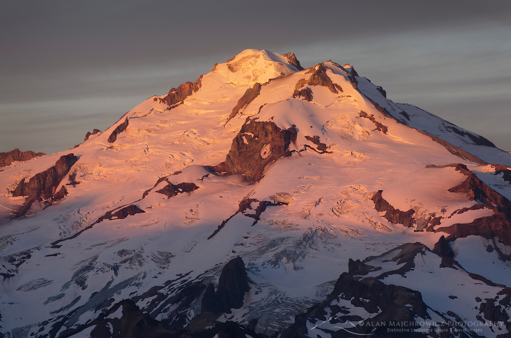 Glacier Peak (10,541′) or Dakobed is the most isolated of the five major stratovolcanoes of the Cascade Volcanic Arc. NE profile seen here. North Cascades Washington