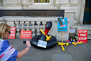 An anti Brexit protester takes a photograph of placards outside the Cabinet Office as the Supreme Court sits for day two of the hearing on the legality of the suspenion of parliament on 18th September 2019 in London, United Kingdom. Supreme Court judges will decide if Prime Minister Boris Johnson acted unlawfully in advising the Queen to prorogue parliament.