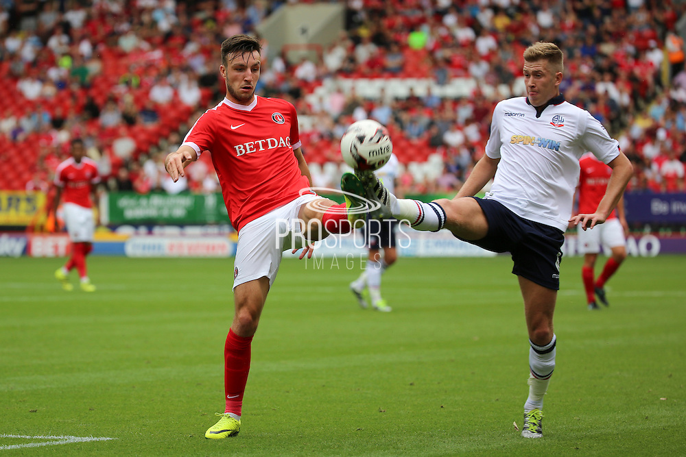 Charlton Athletic defender Morgan Fox (21) and Bolton Wanderers midfielder Josh Vela (6) battles for possession during the EFL Sky Bet Championship match between Charlton Athletic and Bolton Wanderers at The Valley, London, England on 27 August 2016. Photo by Matthew Redman.