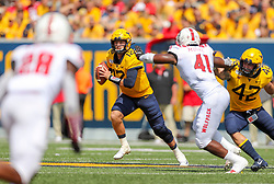 Sep 14, 2019; Morgantown, WV, USA; West Virginia Mountaineers quarterback Austin Kendall (12) looks to pass during the second quarter against the North Carolina State Wolfpack at Mountaineer Field at Milan Puskar Stadium. Mandatory Credit: Ben Queen-USA TODAY Sports