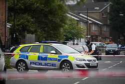 © Licensed to London News Pictures. 28/06/2018. London, UK. Police at the scene where a 20 year old man was stabbed to death yesterday evening in Edmonton, North London. Police were called to reports of a row between men armed with baseball bats on Wednesday evening. Photo credit: Ben Cawthra/LNP