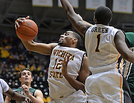 WICHITA, KS - NOVEMBER 14:  Forward Darius Carter #12 of the Wichita State Shockers grabs a defensive rebound against the William & Mary Tribe during the second half on November 14, 2013 at Charles Koch Arena in Wichita, Kansas.  Wichita State defeated William & Mary 79-62. (Photo by Peter Aiken/Getty Images) *** Local Caption *** Darius Carter