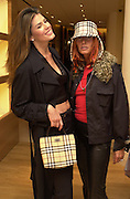 Christina Estrada and Tara Hitckcox. Burberry Bond St. Launch party. 21-23 New Bond St. London. In Support of the Sargent Cancer Care for Children. 7/9/00 © Copyright Photograph by Dafydd Jones 66 Stockwell Park Rd. London SW9 0DA Tel 020 7733 0108 www.dafjones.com
