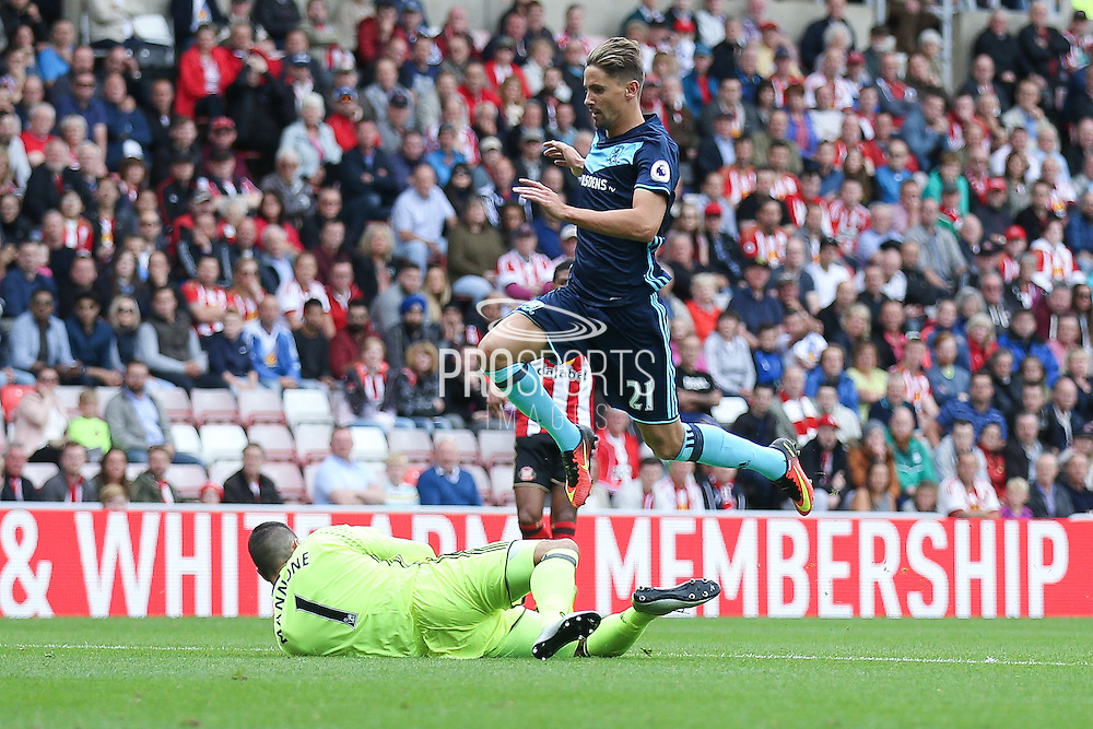 Sunderland goalkeeper Vito Mannone (1)  gets down at the feet of Middlesbrough midfielder Gaston Ramirez (21)  during the Premier League match between Sunderland and Middlesbrough at the Stadium Of Light, Sunderland, England on 21 August 2016. Photo by Simon Davies.