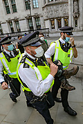Police arrested a young man who was the main suspect to have sprayed a yellow graffiti onto the plinth of the Winston Churchill statue in Parliament Square, central London on Thursday, Sept 10, 2020. Environmental nonviolent activists group Extinction Rebellion enters its 10th and final day of continuous ten days protests to disrupt political institutions throughout peaceful actions swarming central London into a standoff, demanding that central government obeys and delivers Climate Emergency bill. (VXP Photo/ Vudi Xhymshiti)