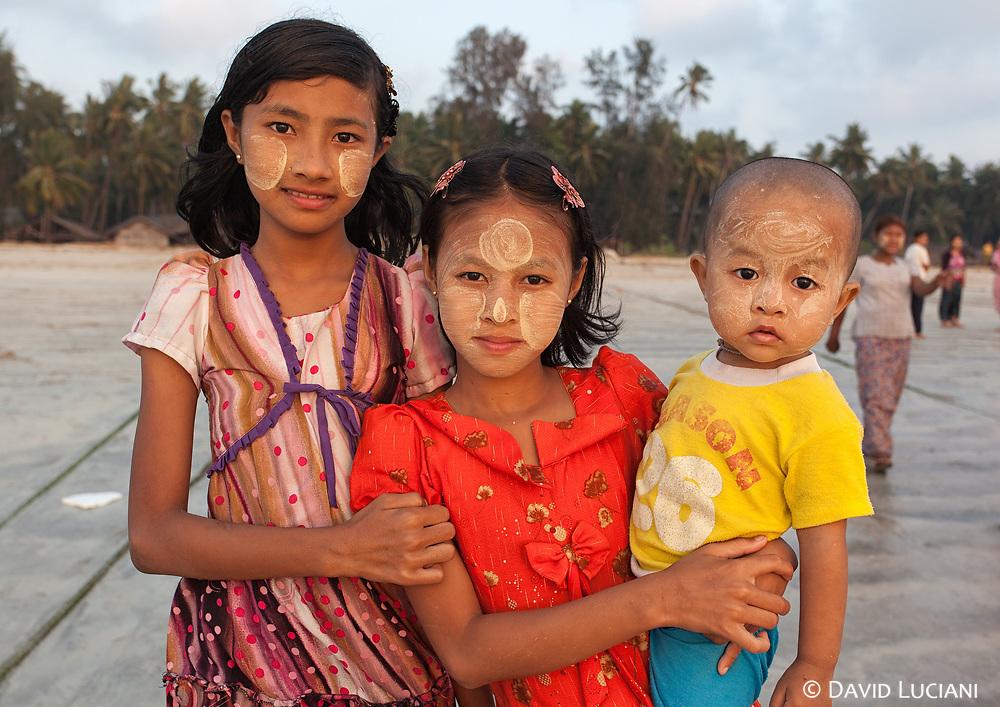 Two girls and a small boy posing in Gyeiktaw Village.