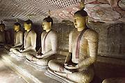 Buddha figures inside Dambulla cave Buddhist temple complex, Sri Lanka, Asia