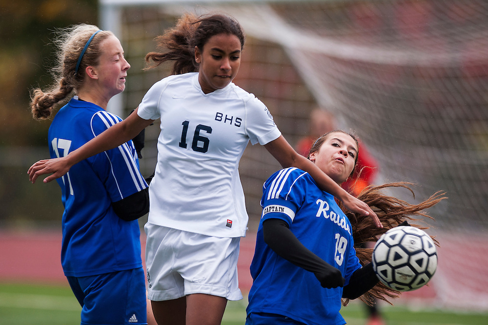 Burlington's Tatum Vachereau (16) battles to head the ball with U-32's Tehya Weston (19) and Lyra Wanzer (17) during the girls playoff soccer game between the U-32 Raiders and the Burlington Sea Horses at Buck Hard Field on Friday afternoon October 24, 2014 in Burlington, Vermont (BRIAN JENKINS, for the Free Press)
